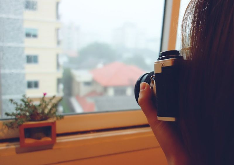 Young woman taking photo of mini plant pot by film camera Film Camera Photography Photographer Photograph Take Photo Plant Pot Mini Little Indoor Room Apartment Lifestyle FreeTime Hobby Enjoy Little Things Happiness Activity Shoot Shooting Photo Vintage Retro Collections