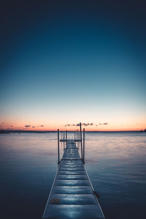 Slippery when wet. Sunset Sky Blue Sea Reflection Pier Water Horizon Over Water Scenics Beauty In Nature Landscape Clear Sky Tranquil Scene Sun Beach Idyllic Jetty Sunlight Tranquility Sunny