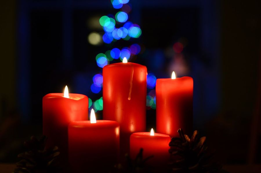 Candle Flame Bokeh Red Glowing Illuminated No People Indoors  Close-up Night Cosy Dark Darkness And Light Christmas Time