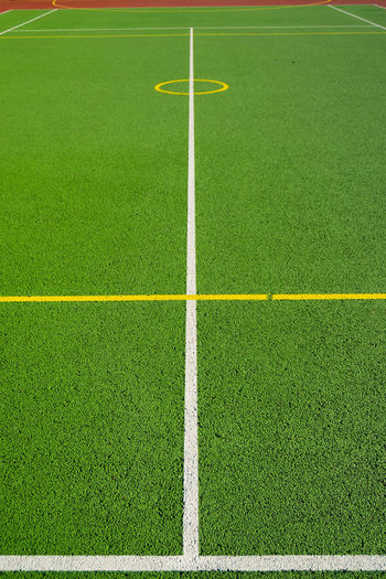 Artificial Grass Day Grass Green Color Leading Lines No People Outdoors Perspective Sport Sports Court Textured  Yellow Circle Yellow Line Astro Turf Line Marking