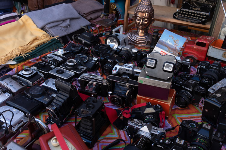Abundance Camera - Photographic Equipment Car Choice Close-up Collection Digital Camera High Angle View Indoors  Large Group Of Objects Market Mode Of Transportation Motor Vehicle No People Photography Themes Retail  Still Life Technology Transportation Variation