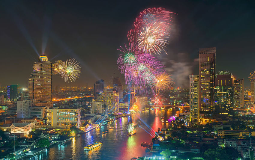 Fireworks' Bangkok New Year 2016, Thailand Bangkok Cityscape Downtown Financial District  Fireworks New Year Thailand Architecture Building Exterior Buildings Built Structure Celebration Chao Praya River City City Life Cityscape Firework - Man Made Object Firework Display Illuminated Long Exposure Modern Multi Colored Night No People Outdoors River Sky Skyscraper Taksin Bridge Tower Travel Destinations Urban Skyline