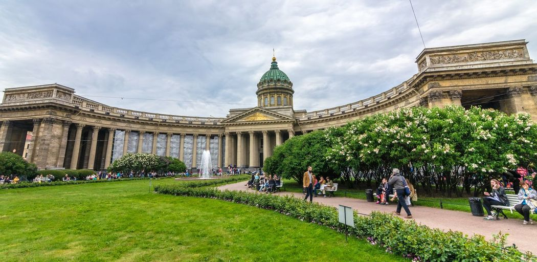 People Walking At Kazan Cathedral Against Cloudy Sky