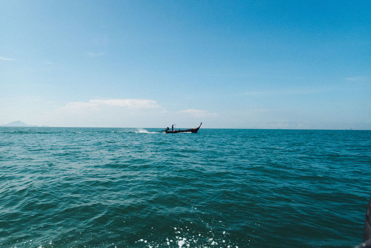 Sea Sky Water Transportation Mode Of Transportation Nautical Vessel Waterfront Scenics - Nature Beauty In Nature Horizon Over Water Horizon Day Nature Blue Tranquility Travel Tranquil Scene One Person Real People Outdoors Turquoise Colored