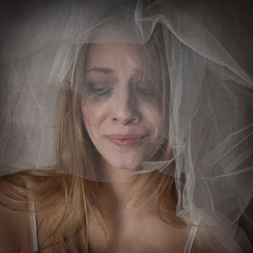 Close-Up Of Crying Bride Wearing Veil