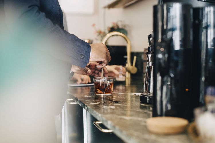 Man pouring coffee in kitchen