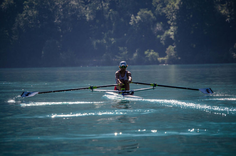 Rowing training session, Brienzersee, Switzerland Backlight Trees Boat Lake Lake Brienz Leisure Activity Motion Nature Oar One Person Outdoors Rowing Single Scull Sport Training Session Water Summer Sports