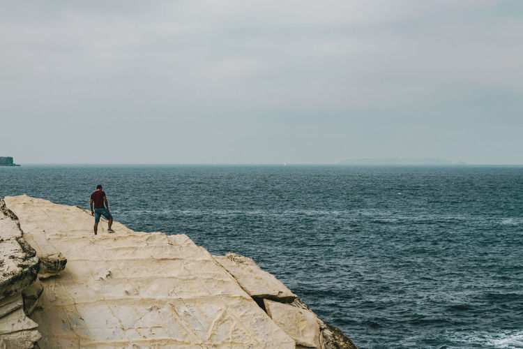 Sea Water Scenics - Nature Rock Sky Real People Beauty In Nature Lifestyles Leisure Activity Rock - Object Horizon Over Water Horizon Solid Nature Full Length Day Standing People Outdoors Men