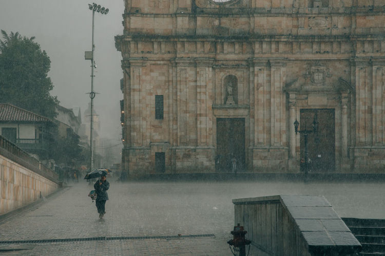 Rain Raining Rainy Days Rainy Season Rainy City City Bogotá Colombia South America Latin America Architecture Building Exterior Built Structure Real People Men One Person Building Day Lifestyles Wet Full Length Water Umbrella Outdoors