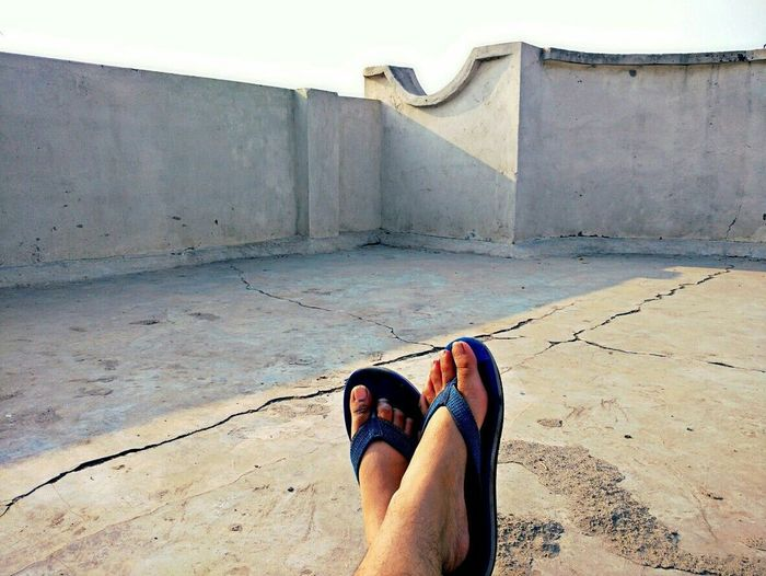 Low Section Outdoors Sunny Day Feet Minimalism Carefree Freshness Terrace Dreamy Relax EyeEmNewHere Photography Human Body Part One Person Day Architecture People Run Free EyeEmNewHere Minimalist Architecture The City Light