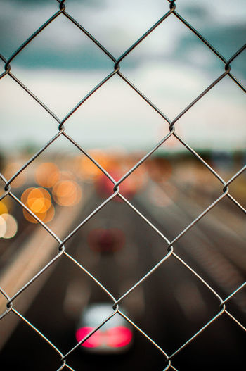 Endless road trip 🌇 Chainlink Fence Metal Security Full Frame Protection No People Backgrounds Close-up Sky Pattern Outdoors Day Nature Car Bokeh Bokeh Photography Discovery Sunset Personal Perspective Focus Focal Point Perspective Unfocused City Selective Focus