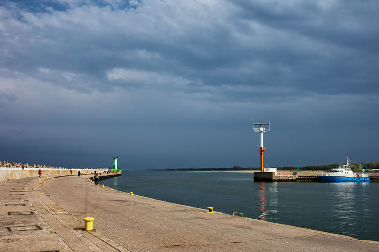 Entrance to the Wladyslawowo port at Baltic Sea in Poland Bad Weather Baltic Baltic Sea Entrance Poland Stormy Weather Built Structure Clouds Europe Pier Port Quay Sea Seaside Sky Stormy Sky Waterfront Wharf Wladyslawowo