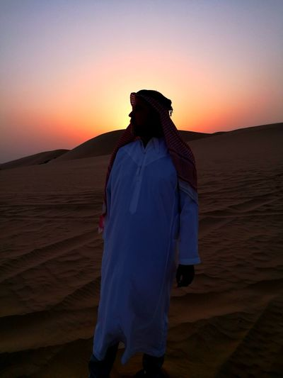 Full Length Of Arab Man Standing In Desert