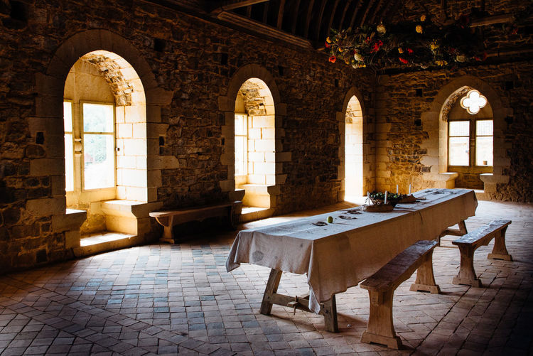Windows Window Arch Bench Benches Stone Wall Living Room Interior Table Medieval Medieval Architecture Party Fest Architectural Column Chair History Arch Place Of Worship Architecture Built Structure Historic Ancient The Past Palace Historic Building Castle