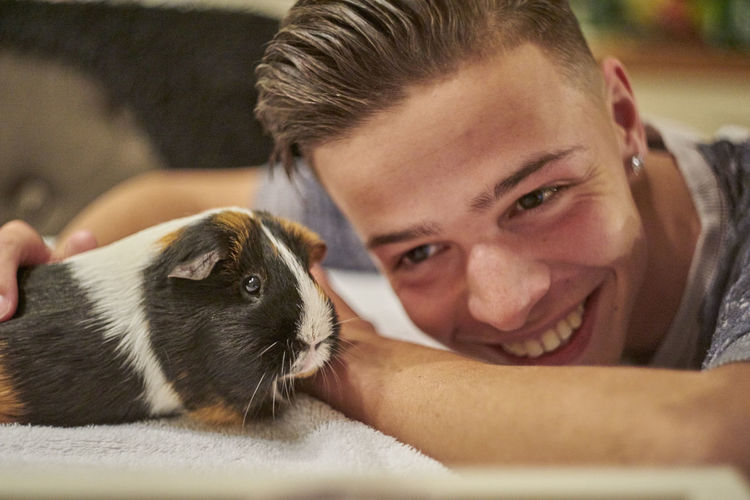 Bonding Close-up Day Domestic Animals Friendship Happiness Headshot Indoors  Looking At Camera Love Mammal One Animal One Person People Pets Pigeon Portrait Real People Smiling Young Adult