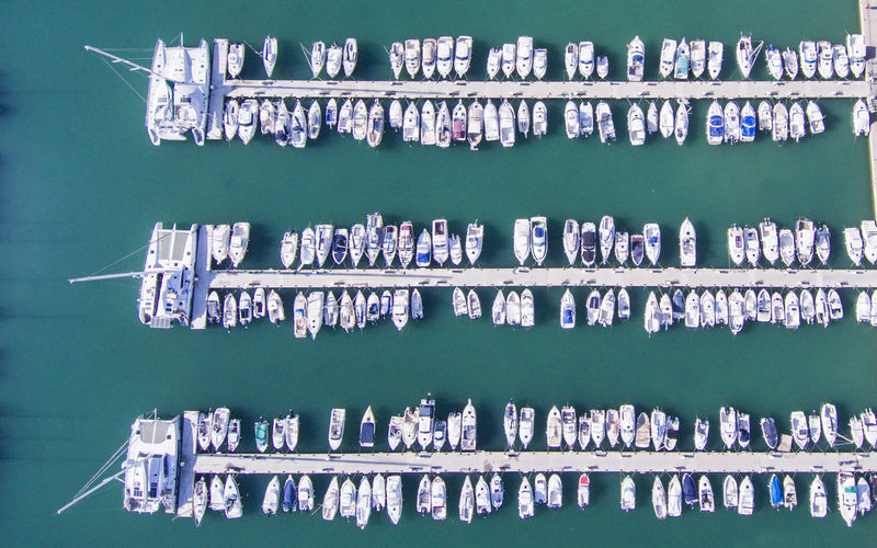 Aerial view of boats moored on sea at harbor