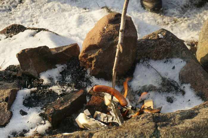 grilling sausages on a campfire Outdoors No People Grilling Out Grilling Lifestyle Campinglife Lifestyles Tranquility Outdoor Campfire Winter Snow Norway Cold Days Cold Cold Temperature Outdoors Photograpghy  Tranquil Scene Flame Flames