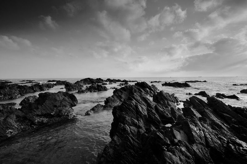 Amazing rock formations at Pandak beach, Terengganu in black and white monochrome fine art technique.  Nature composition blur soft focus noise visible due to long exposure effect. Fine Art Black And White Landscape Amazing View Amazing Black&white Fine Art Photography Terengganu Black Malaysia Wallpaper EyeEm Backgrounds Blackandwhite Water Sea Beach Sand Horizon Rock - Object Wave Sky Horizon Over Water Cloud - Sky Low Tide Seascape