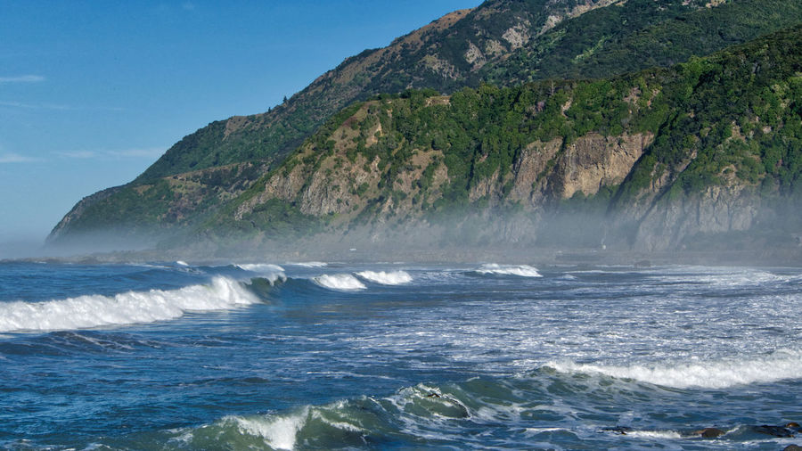 Morning fog along the Kaikoura coast, South Island, New Zealand Kaikoura New Zealand Landscape Beauty In Nature Clear Sky Day Fog Motion Mountain Nature New Zealand No People Outdoors Pacific Ocean Scenery Scenics Sea Sky Water Waterfront Wave