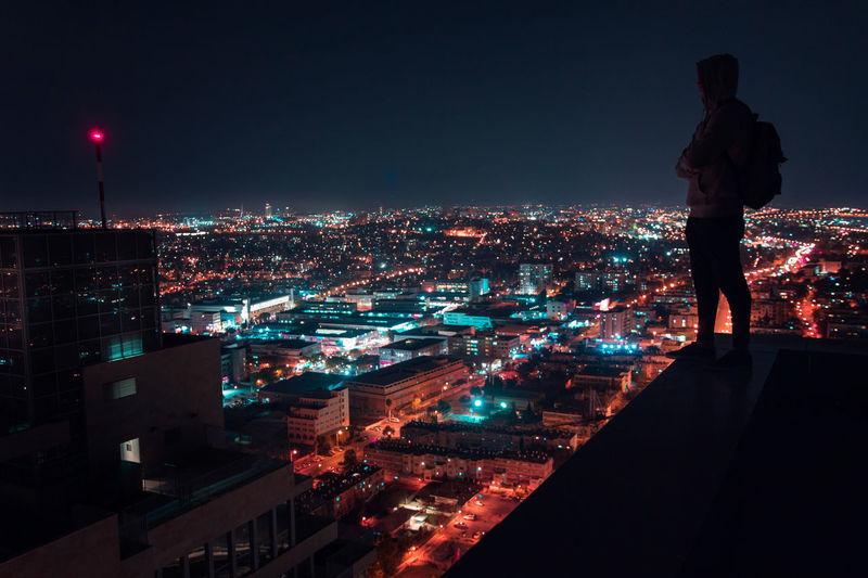 The Light Chaser Jerusalem EyeEm Selects City Cityscape Illuminated Urban Skyline Full Length Skyscraper Standing Arts Culture And Entertainment Sky