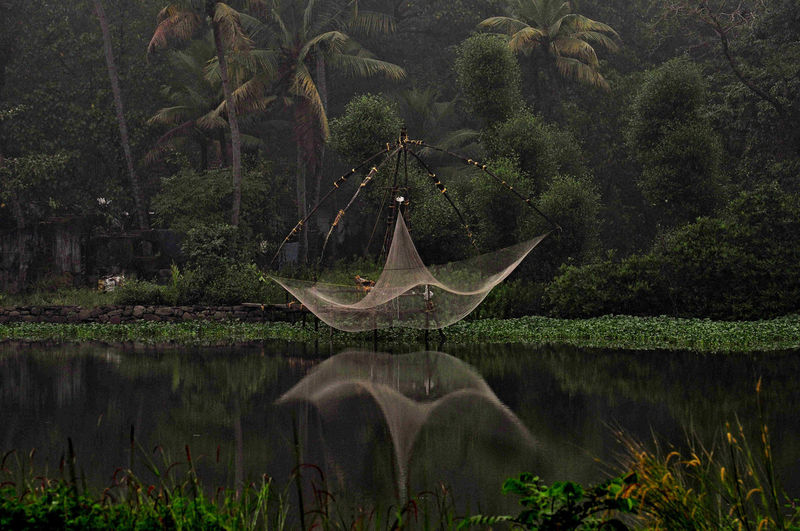 Chinese Fishing net in Kerala, India Beauty In Nature Chinese Fishing Net Day Doubleexposure Fishing Net Idyllic Incredible India Kerala The Gods Own Country ;) Nature No People Outdoors Reflection River Tranquil Scene Tranquility Water