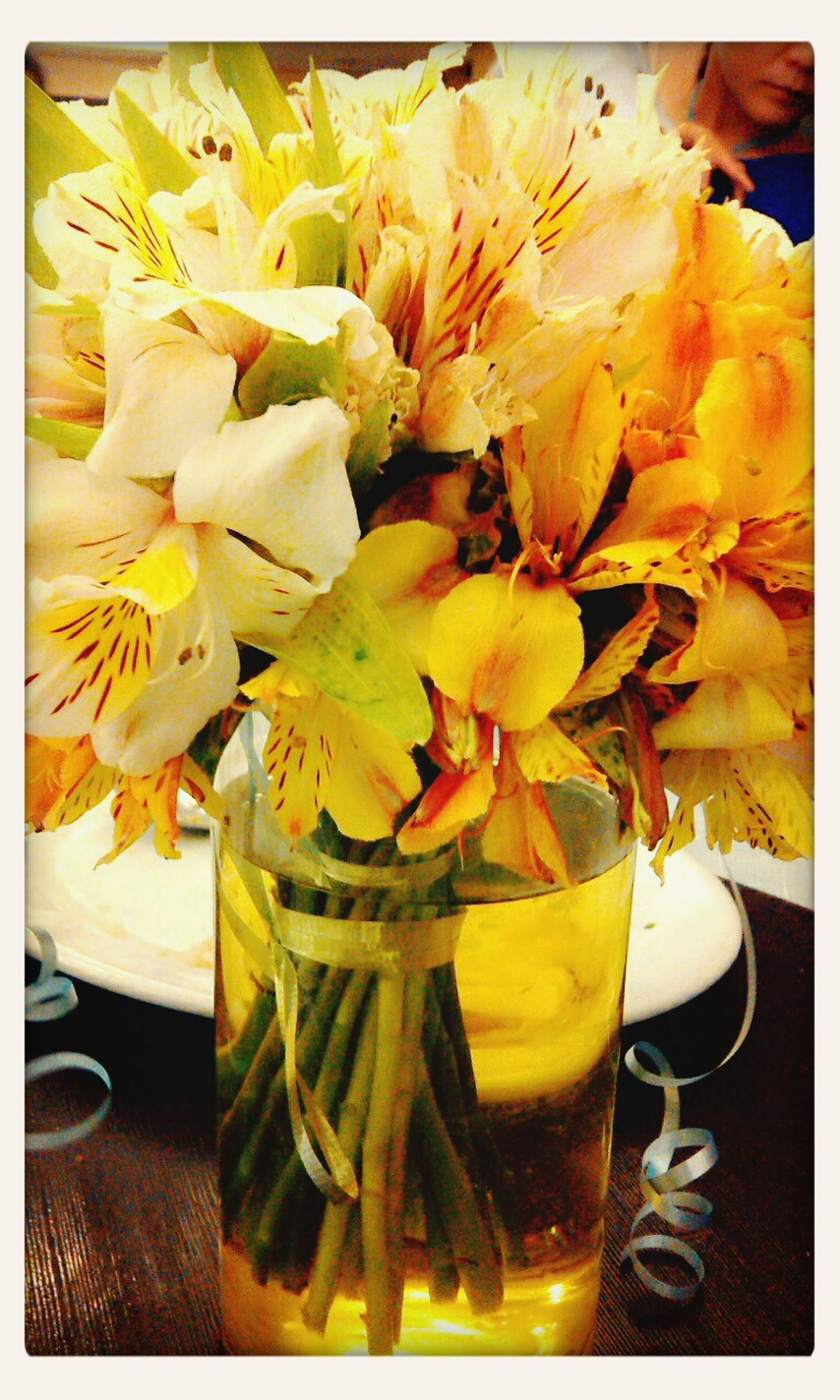 transfer print, freshness, indoors, auto post production filter, flower, food and drink, yellow, table, close-up, still life, fragility, healthy eating, petal, vase, food, high angle view, no people, leaf, refreshment, flower head