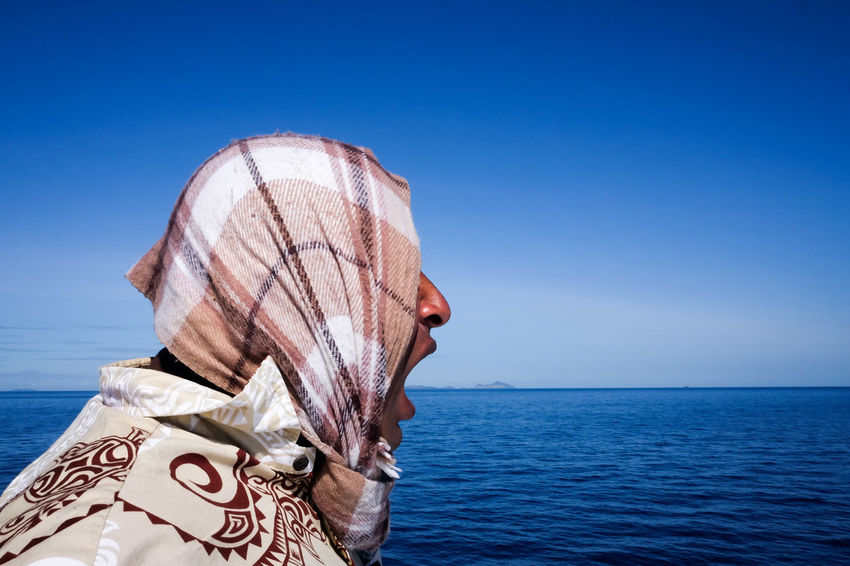 Streetphotography Street Photography Scarf Man Fiji Fiji Islands Man Sea Water Horizon Over Water Blue Sky One Person Adults Only Day Outdoors Adult People Clear Sky Nature Close-up