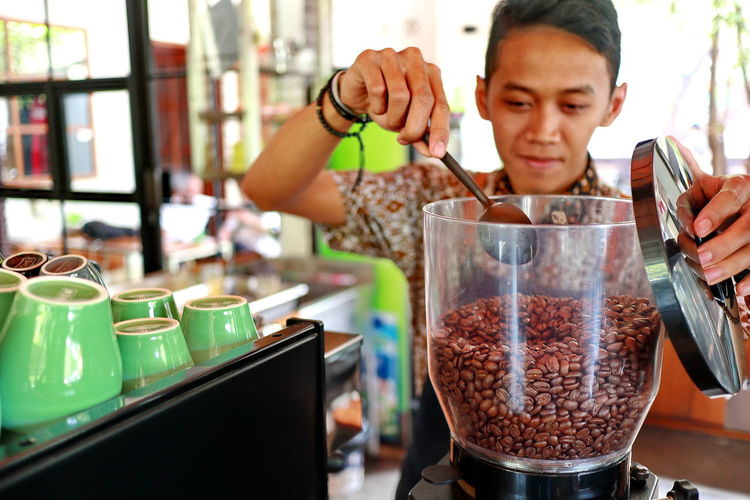 Barista Preparing Coffee At Cafe