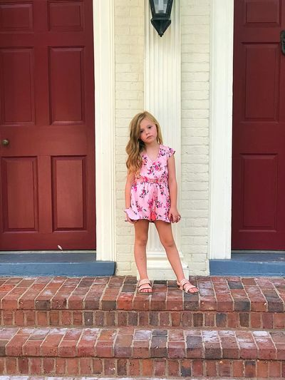 Full length of girl standing on steps