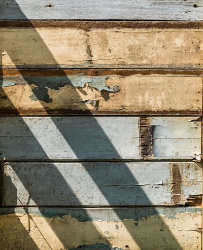 Sunlight on old wooden wall. Abrasive Architecture Backgrounds Barn Beautiful Building Exterior Chipping Paint Countryside Decorative Fashion Hardwood Floor Outdoors Rough Sunlight Surfcenter Amsterdam Textured  Tradition Vintage Weathered