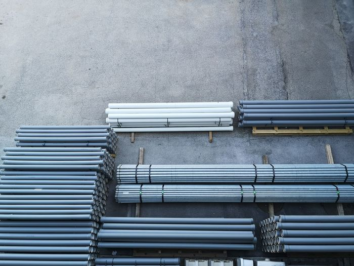 Metal grate against building in city