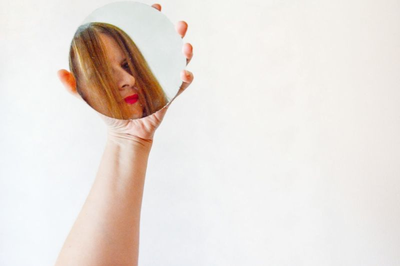 Portrait Photography Portraiture Point Of View Circle Geometric Shape Mirror Reflection Portrait Of A Woman Creative Portrait Minimal EyeEm Selects Human Hand Portrait Holding Personal Perspective Hand Raised Optical Illusion Posing Pretty Looking At Camera