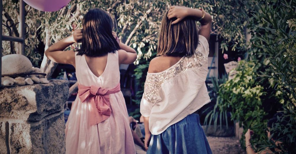 Back of two girls at a party