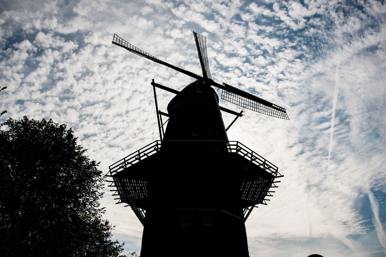 Low Angle View Of Traditional Windmill Against Cloudy Sky