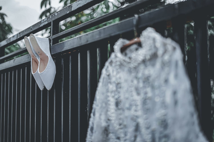 Close-up of clothes hanging on railing