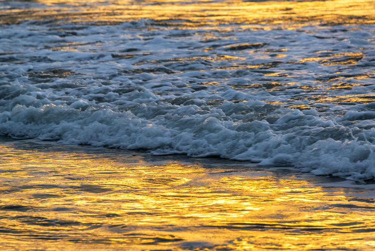 Pacific Ocean bathed in golden light at sunset in Same, Ecuador Beach Beauty In Nature Day Ecuador Golden Light Landscape Motion Nature No People Ocean Orange Orange Color Outdoors Pacific Pacific Ocean Same  Sea South America Sunset Tourism Travel Travel Destinations Water Wave Waves