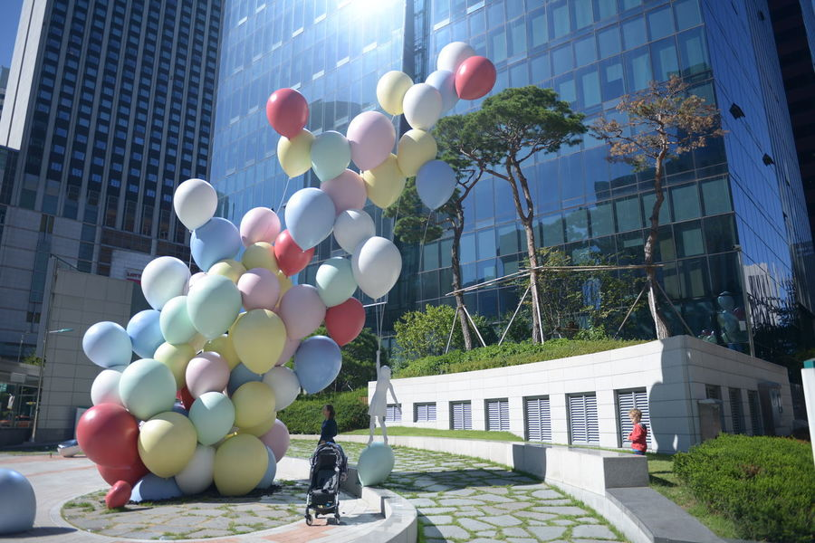 Architecture Balloon Building Building Exterior Built Structure City City Life Day Decoration Multi Colored Nature No People Office Building Exterior Outdoors Plant Residential District Sky Skyscraper Street Sunlight