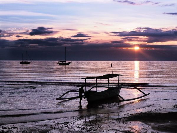 Fishing boat on the beach in Lovina Bali Sunset Water Sea Beauty In Nature Nautical Vessel Scenics Transportation Sky Mode Of Transport Nature Silhouette Cloud - Sky Horizon Over Water Tranquility No People Moored Tranquil Scene Outdoors Beach Outrigger INDONESIA Lovina Beach Bali Fishing