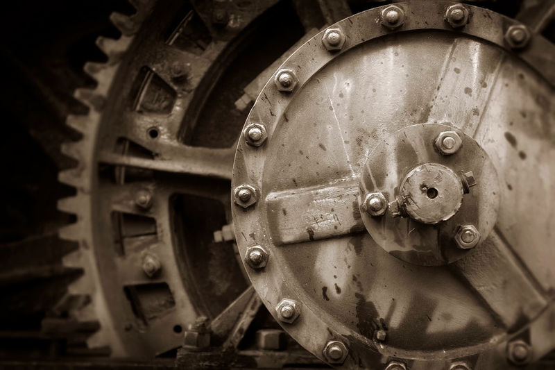 Gears and Wheels. Industrial detail of machinery associated with earth moving equipment. Black & White Nuts Retro Black And White Bolts Close-up Equipment Gear Industrial Equipment Industry Machine Part Machinery Manufacturing Equipment Metal No People Obsolete Old Retro Styled Rusty Rusty Metal Selective Focus Sepia Technology Transportation Wheel