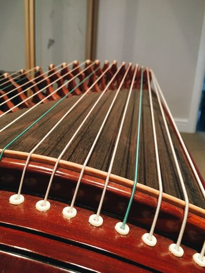 Guzheng - Chinese zither. Guzheng Zither Musical Instrument Musical Equipment String Instrument Music Musical Instrument String String Arts Culture And Entertainment Still Life Day Acoustic Guitar In A Row Detail Close-up Focus On Foreground Wood - Material Brown No People Indoors  Guitar Selective Focus