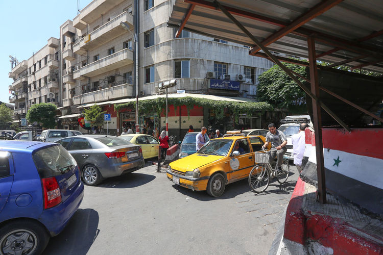 Cars on road in city