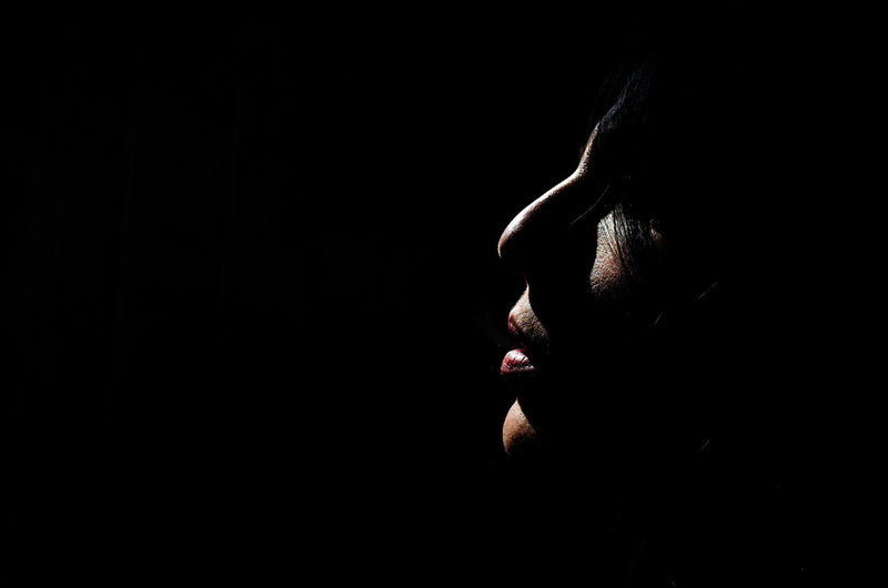 Black Background Studio Shot Headshot One Person Copy Space Indoors  Portrait Human Body Part Close-up Body Part Side View Dark Human Face Lifestyles Young Adult Adult Cut Out Women Real People Contemplation Profile View