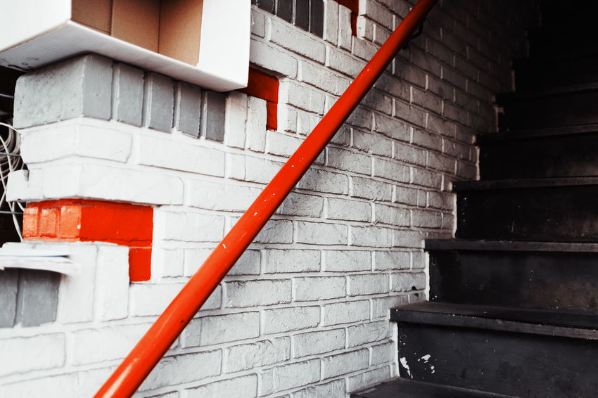 No People Outdoors Staircase Architecture Steps And Staircases Built Structure Building Exterior Wall - Building Feature Railing Red Building Day Wall House Pipe - Tube Brick White Color Pattern Pipe Pipeline