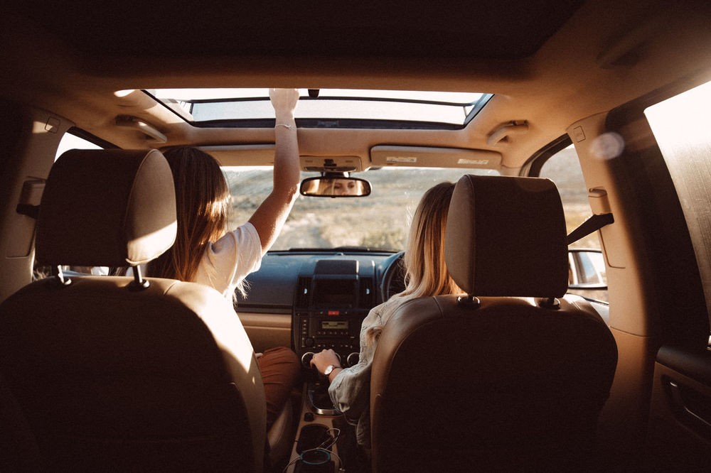 Fun Happy Vacations Adult Car Car Interior Driving Journey Land Vehicle Lifestyles Mode Of Transportation Motor Vehicle Outdoors People Real People Rear View Road Trip Roadtrip Seat Sitting Transportation Travel Vehicle Interior Vehicle Seat Women