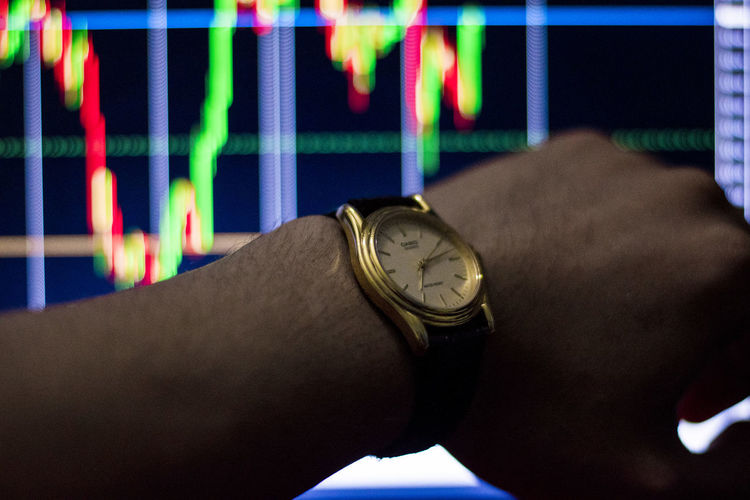 See stock chart time See Stock Chart Time Human Body Part Time Human Hand Hand Watch Real People Body Part Wristwatch One Person Clock Indoors  Close-up Lifestyles Focus On Foreground Unrecognizable Person Men Instrument Of Time Human Limb Limb Finger Personal Accessory