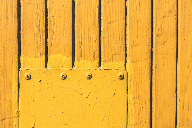 Full Frame Shot Of Yellow Wooden Door