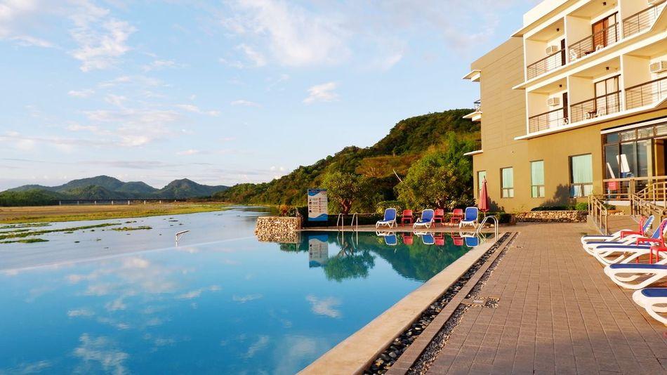 Pool at Rivermount Hotel, Sarrat, Ilocos Norte Calmness Relaxing Peaceful Scenic Water Mountain Swimming Pool Tree Lake Reflection Idyllic Blue Sky Architecture Infinity Pool Tourist Resort Resort Poolside Hotel