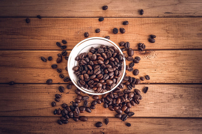 Coffee on grunge wooden background Brown Cappuccino Close-up Coffee - Drink Coffee Bean Coffee Cup Directly Above Drink Food Food And Drink Freshness Group Of Objects High Angle View Indoors  Large Group Of Objects Latte Mocha No People Raw Coffee Bean Raw Food Refreshment Roasted Roasted Coffee Bean Table Wood - Material