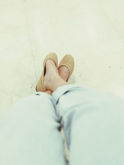 Low section of woman wearing shoes