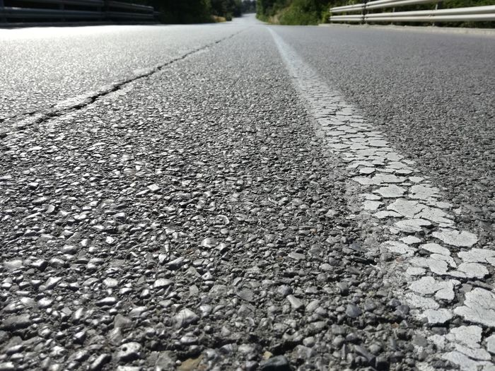 Road Day Textured  Asphalt Outdoors Transportation No People The Way Forward Nature Close-up Road Trip Roadside Shots Roadway Roadlife Asphaltography Asphalt Road Roadsidephotography Road Marking Asphalt Street Roadtrip Roads Roadside Transportation Textured  Surface Level